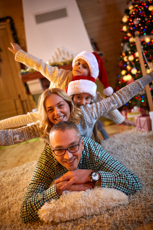 atmosphere: Christmas atmosphere in happy family on Christmas eve Stock Photo