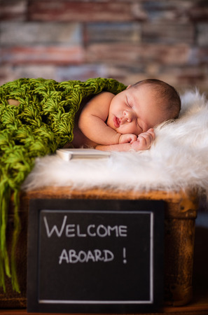 innocence:  Sweet and innocence newborn baby sleeping on softy blanket Stock Photo