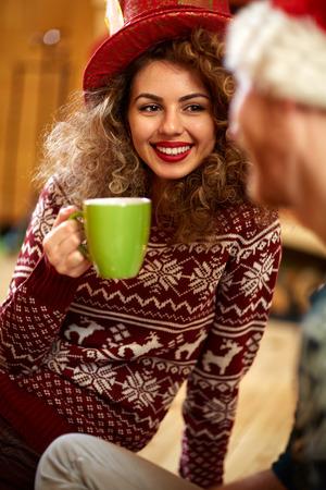 Curly girl enjoying and drinking tea