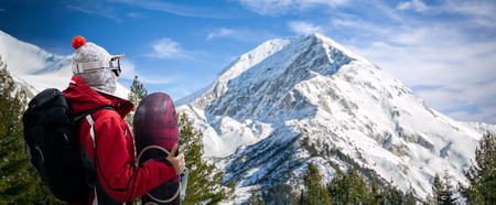 snowboarder  with snowboard looking in beautiful mountain Stock Photo