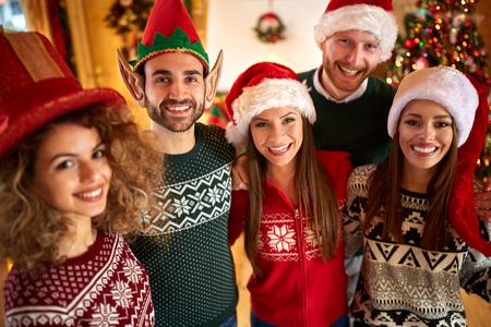 holyday: Cheerful friends makes fun on Christmas holyday