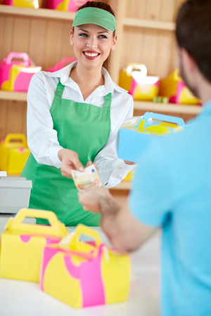 chocolate biscuit: Buying cakes to go in colorful boxes in confectionery Stock Photo
