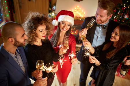 celebrate year: Friends celebrate New Year with sparkles and Champaign Stock Photo