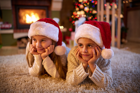 magic eye: children waiting for Santa Claus on Christmas eve Stock Photo