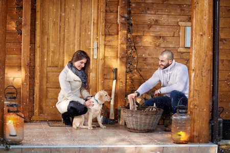 holyday: Girl and man prepare firewood on winter holyday