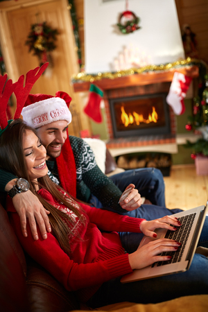 shinning:  Young couple purchase Christmas shopping on line from laptop