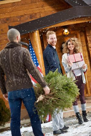 female christmas: Happy male and female preparing Christmas celebration on mountain Stock Photo