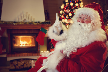 obedient: Real Santa Claus threaten children to be obedient, gesture with finger