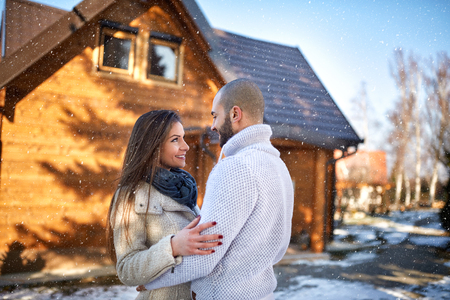 nice house: Nice couple in love in front of mountain house
