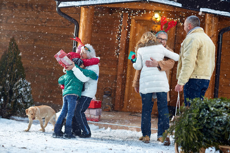 holiday gathering: Christmas, family, holiday- Happy grandparents gathering family