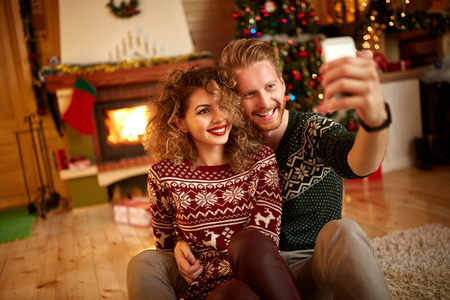 female christmas: Male and female taking selfie for Christmas Stock Photo