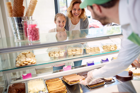 ice cream woman: Mother takes daughter to pastry shop