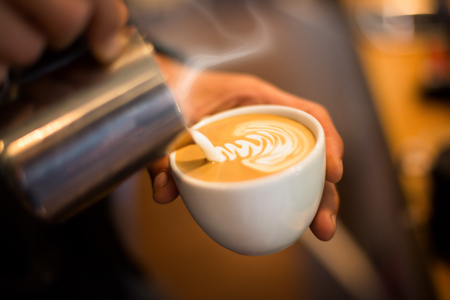 Making of cafe latte art leaf shape 스톡 콘텐츠