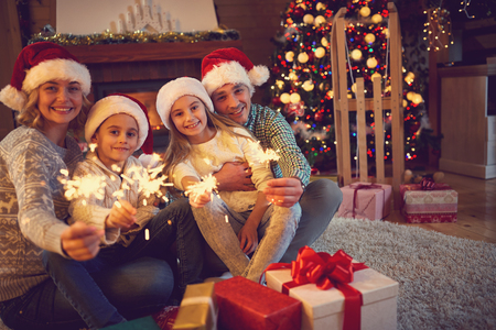 family time: happy family time -family celebrating Christmas  eve Stock Photo