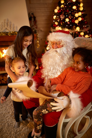 wish  list:  Real Christmas father reading wish list with chlidren