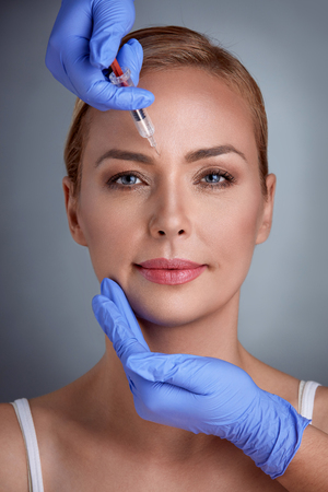 forehead: middle age receiving treatment of botox