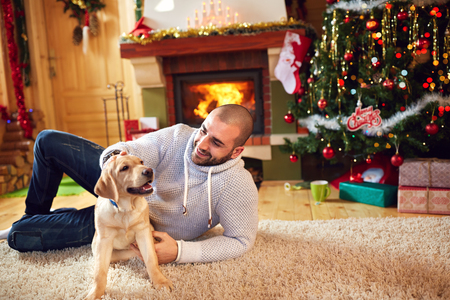 Man cuddling dog and enjoying for Christmas holiday