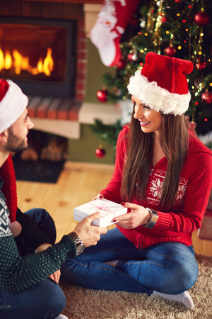 shinning: Male and female giving gifts for Christmas