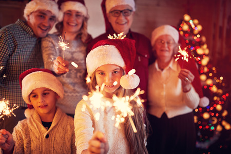happy family at Christmas with funny sparklers Stock Photo