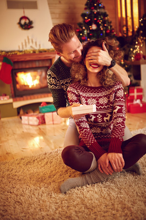 shinning: Man surprise woman with gift for Christmas