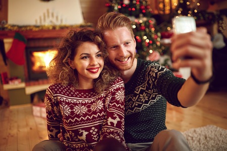 cute christmas: Couple photographing Christmas selfie together