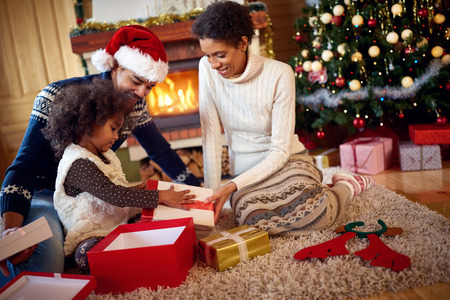 traditional opening Christmas present in afro American family Standard-Bild