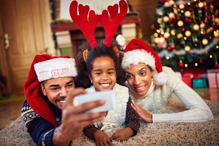 black family with lovely little daughter taking christmas selfie together stock photo 67398353 - Black People Christmas