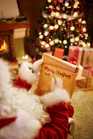 wish  list: Christmas wish list in Santa?s hands