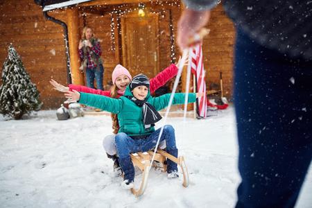 pappy: Family enjoying -winter, snow, family sledding at winter time Stock Photo