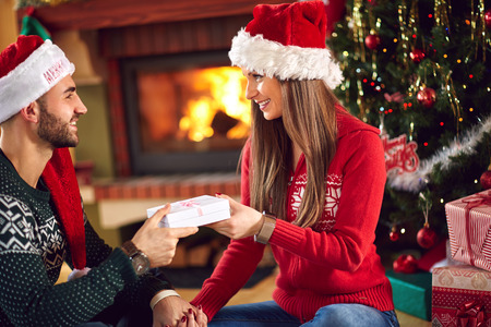 female christmas: Male giving Christmas gift to female