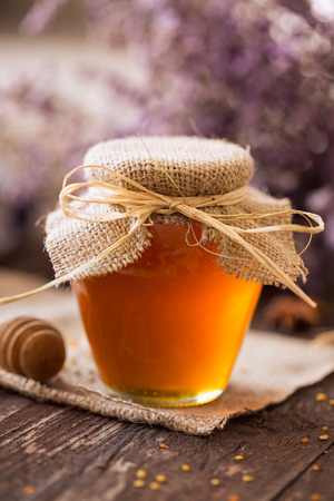 Natural honey. golden honey in glass jar background Stock Photo