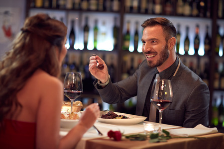 eat out: Couple enjoying in good food in restaurant