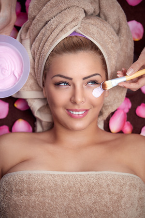 hydration: Young beautiful woman receiving hydration facial mask in spa beauty salon