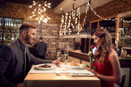 romantic date: Couple in love celebrate Valentines Day with romantic dinner