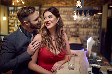 Man flirt to beautiful woman inside at evening