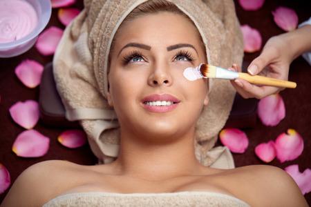 beauty women receiving treatment of  facial mask