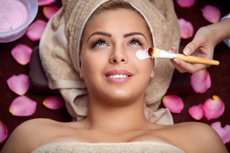beauty women receiving treatment of  facial mask