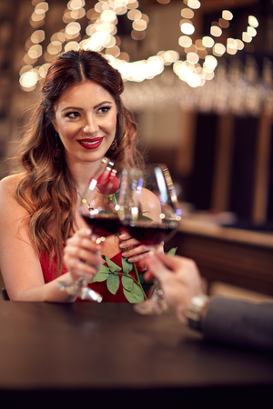 Beautiful woman toasting in bar Stock Photo