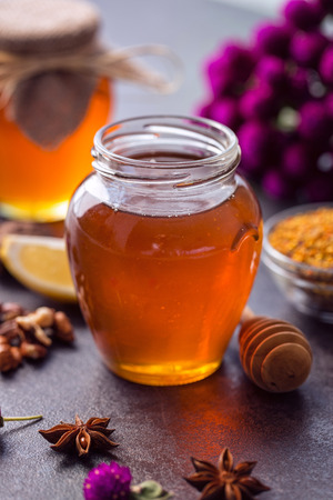 jar of sweet natural honey on table Stock Photo