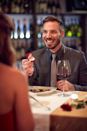 engaged: Happy man engaged woman in restaurant Stock Photo
