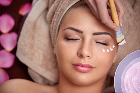 beautiful woman  on treatment of cosmetic mask