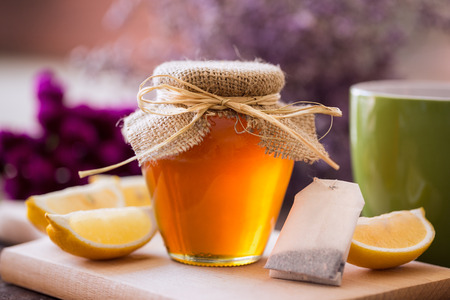 hot cup of tea with honey and lemon background