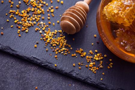 bee pollen: honey bee product pollen propolis on the table Stock Photo