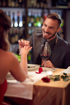 engaged: Cheerful male engaged woman in restaurant Stock Photo