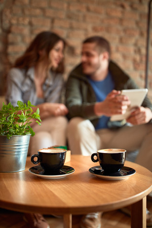 Couple of coffee cups on the table in cafeteria Stock Photo