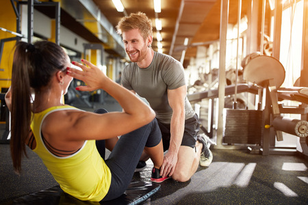 Fitness training with trainer in gym Standard-Bild