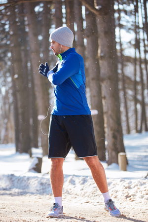 Male jogger exercise in nature at winter Stock Photo