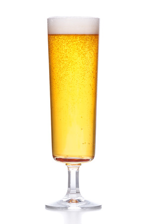 light beer with foam on white background Фото со стока