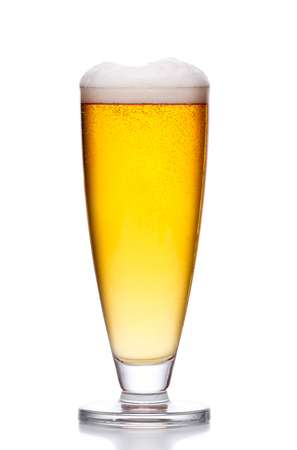 cold background: glass of cold light beer with foam on white background
