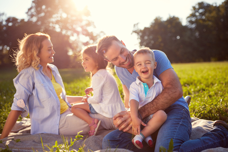 Young family with children having fun in nature Standard-Bild